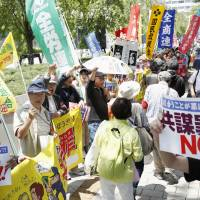 Protesters rally near the Diet building on Friday as the ruling bloc pushed the controversial conspiracy bill through the Lower House committee. | KYODO