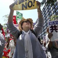 Protesters shout slogans denouncing the conspiracy bill during a rally in front of the Diet building in Tokyo on Tuesday. | AP