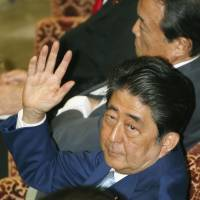 Prime Minister Shinzo Abe prepares to answer a question Monday during a Lower House Budget Committee session. | KYODO