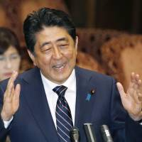 Prime Minister Shinzo Abe speaks at the Upper House Budget Committee Tuesday. | KYODO
