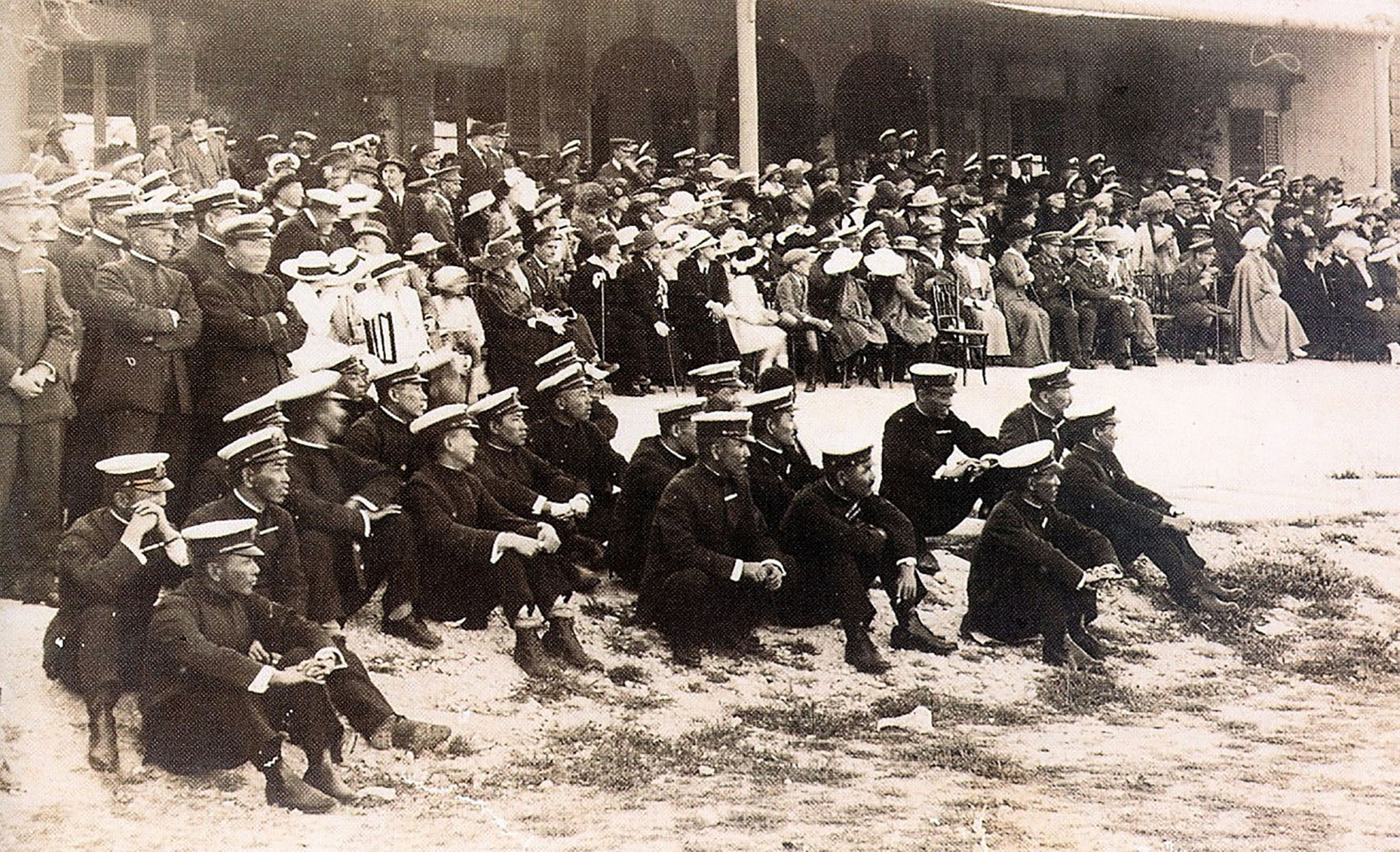 A World War I-era photograph from Malta's National War Museum shows Imperial Japanese Navy officers sitting on a beach on the island in the Mediterranean Sea.   KYODO
