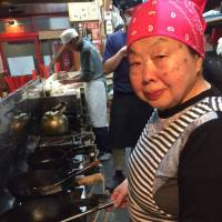 Sumiko Iwamuro cooks at her family-run restaurant in Tokyo. She works there during daytime before rocking the club scene at night. | KYODO