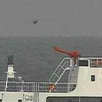 What appears to be a drone flies above one of the four China Coast Guard vessels Thursday morning after they entered Japanese waters around the Senkaku Islands in the East China Sea. | JAPAN COAST GUARD / VIA KYODO