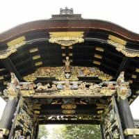 Tourists take photos of Nishi Honganji Temple's Karamon gate in Kyoto on Sunday. The decorative gate was opened for the first time in 34 years to mark the birthday of Shinran, a 12th century monk who founded the Jodo Shinshu school of Buddhism. | KYODO