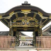 Tourists see the Karamon gate of the Nishi Honganji Temple opened in Kyoto on Sunday. | KYODO