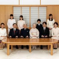 Emperor Akihito and Empress Michiko pose with their family members during a photo session at the Imperial Palace in Tokyo in 2016. | REUTERS