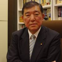 Former defense chief courts controversy by questioning Abe plan to revise Constitution