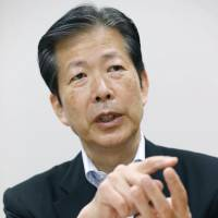 Abe's coalition ally warns military shift could rile neighbors