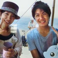 A provided photo taken in 2010 shows Kei Komuro, who was serving as a tourism ambassador for Fujisawa, Kanagawa Prefecture, along with Rina Namikawa (left) and others serving in the same capacity. | KYODO
