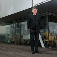 Using Japanese lumber for the centerpiece venue,Kengo Kumawants to restore woods that Tokyo lost half a century ago in the blitz to build highways, bullet trains and skyscrapers to showcase the recovery from wartime devastation. | BLOOMBERG