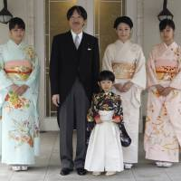 Prince Hisahito is accompanied by his parents, Prince Akishino and Princess Kiko, and his sisters, Princess Mako (left) and Princess Kako (right), after attending a ceremony to celebrate his growth and the passage from infancy to childhood, at the Akasaka Imperial Estate in Tokyo on Nov. 3, 2011. | AP
