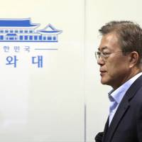 Japan could hold talks with new South Korean President Moon Jae-in in July or earlier, diplomatic sources say. | AP