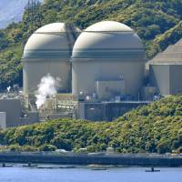 Kansai Electric Power Co.'s Takahama No. 3 reactor (left) in Fukui Prefecture is set to be rebooted soon. The government is accelerating its efforts to restart the reactors idled after March 2011 but has made no decision on building final disposal facilities for the accumulating spent fuel. | KYODO