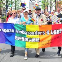 Marchers carry the rainbow flag during the annual Tokyo Rainbow Pride event held in the Shibuya district of central Tokyo on Sunday. This year's theme was 'change,' a call to respect everyone as individuals, regardless of their sexuality.   YOSHIAKI MIURA
