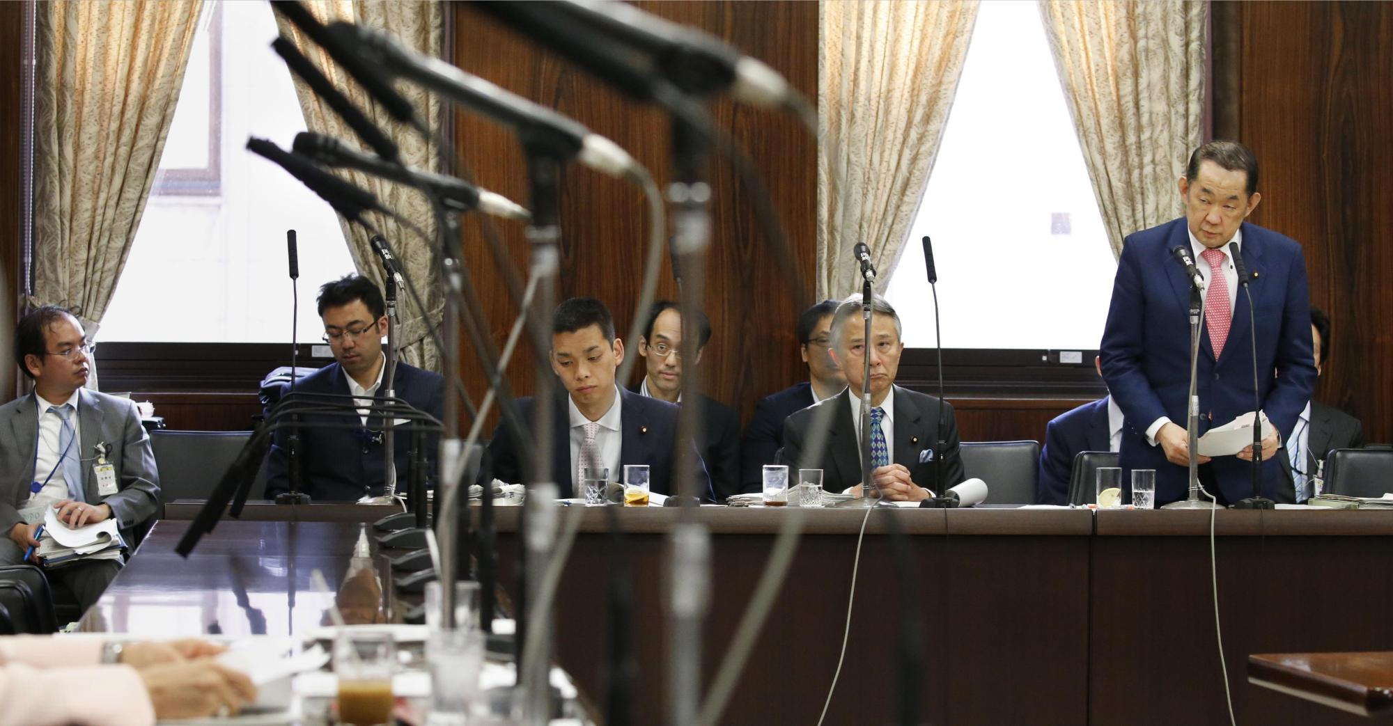 Justice Minister Katsutoshi Kaneda speaks at an Upper House committee meeting Tuesday during deliberations over the contentious conspiracy bill. | KYODO