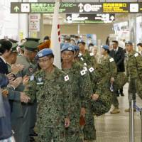 The last Ground Self-Defense Force members engaged in the U.N. peacekeeping mission in South Sudan return to Aomori Airport on Saturday. | KYODO