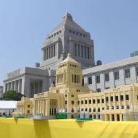A miniature replica of the Diet made of Lego blocks is displayed in the front yard of the House of Councilors on Saturday to mark the 70th anniversary of the upper chamber's founding. | KYODO