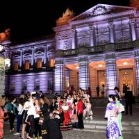 Participants take pictures at the Government Guesthouse in Akasaka, Tokyo, last Thursday during the Global Summit of Women's welcoming dinner. | SATOKO KAWASAKI