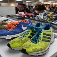 Shoes are among items on sale at a secondhand market of unclaimed goods in Saikaya department store in Fujisawa, Kanagawa Prefecture, in April. | SATOKO KAWASAKI