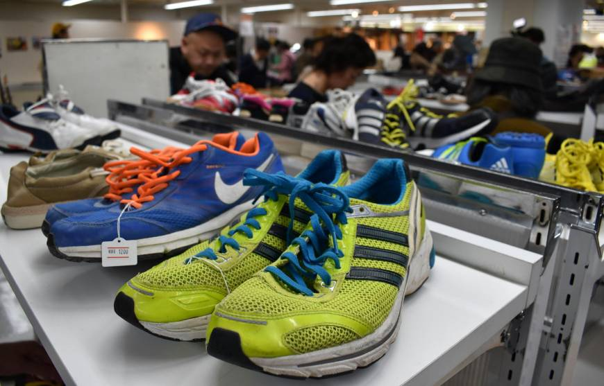 Shoes are among items on sale at a secondhand market of unclaimed goods in Saikaya department store in Fujisawa, Kanagawa Prefecture, in April.