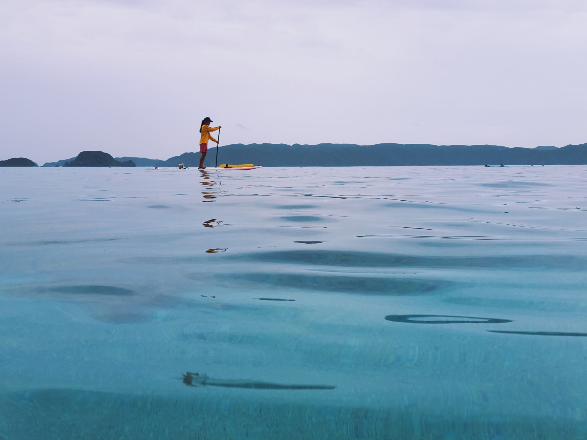 Another day at the office: A lifeguard navigates the waters off Zamami Island. | ANDREW CURRY