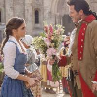 The real beast: Belle (Emma Watson) speaks with the town's macho man, Gaston (Luke Evans). | © 2017 DISNEY ENTERPRISES, INC. ALL RIGHTS RESERVED