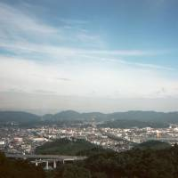 The city of Kojima, famed for its jeans makers, stretches out below Washuzan. | CAMERON MCKEAN