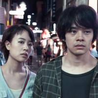 Take to the sky: Shizuka Ishibashi (left) and Sosuke Ikematsu endure Tokyo's grit. | © 2017 'THE TOKYO NIGHT SKY IS ALWAYS THE DENSEST SHADE OF BLUE' FILM PARTNERS