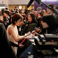 Overseas outreach: Actress Aya Ueto signs an autograph at the recent Udine Far East Film Festival. | © 2017 PHOTO PAOLO JACOB/FEFF 19