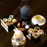 InterContinetal Tokyo Bay's afternoon tea is served in Japanese-style tiered jubako lacquered lunch boxes. | COURTESY OF INTERCONTINENTAL TOKYO BAY