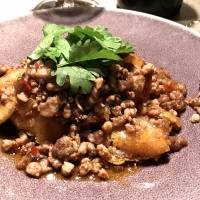 A stir-fried dish of fresh figs that are deep-fried as fritters and buried under coarsely ground pork that has been stir-fried with delicate shards of pickled red chili | ROBBIE SWINNERTON