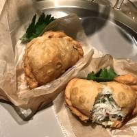 The daikon pies at Mimosa are empanada-like pastries, filled with shredded white radish mixed with specks of umami-rich Jinhua ham and finely diced negi scallions | ROBBIE SWINNERTON