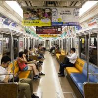 Each week, on the morning that weekly magazines go on sale, commuter trains and other transport in Japan's major metropolitan areas carry ads — referred to as shanai kōkoku (train ads) or tsuri kōkoku (hanging ads) — that spell out the magazine's latest headlines. | ISTOCK