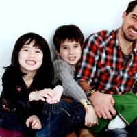 Happier times: Paul Halton with his children (left to right) Hana, Junta and Talo. 'The likelihood is that they will remain in Japan for the rest of their lives and so even my unborn grandchildren will be distant and possibly unknown to me,' Halton says.
