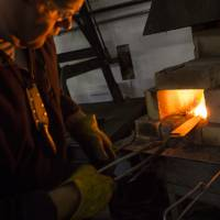 Murray Carter forges a blade in his kiln in Portland. | CHRISTINA SJOGREN