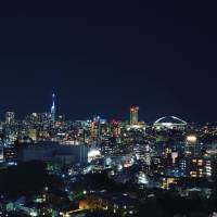 Boomtown: The city at night, with Fukuoka Tower, the city's tallest building, and Fukuoka Dome lit up. | OSCAR BOYD