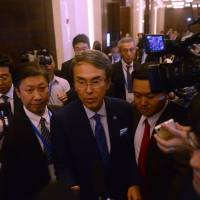 Economic and fiscal policy minister Nobuteru Ishihara speaks to reporters after a Trans-Pacific Partnership meeting Sunday on the sidelines of the Asia-Pacific Economic Cooperation gathering in Hanoi where it was agreed to try to resuscitate the free trade pact. | AFP-JIJI