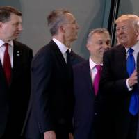 In this image from NATO TV, U.S. President Donald Trump appears to push aside Montenegro Prime Minister Dusko Markovic after taking part in a group photo on May 25. | AP