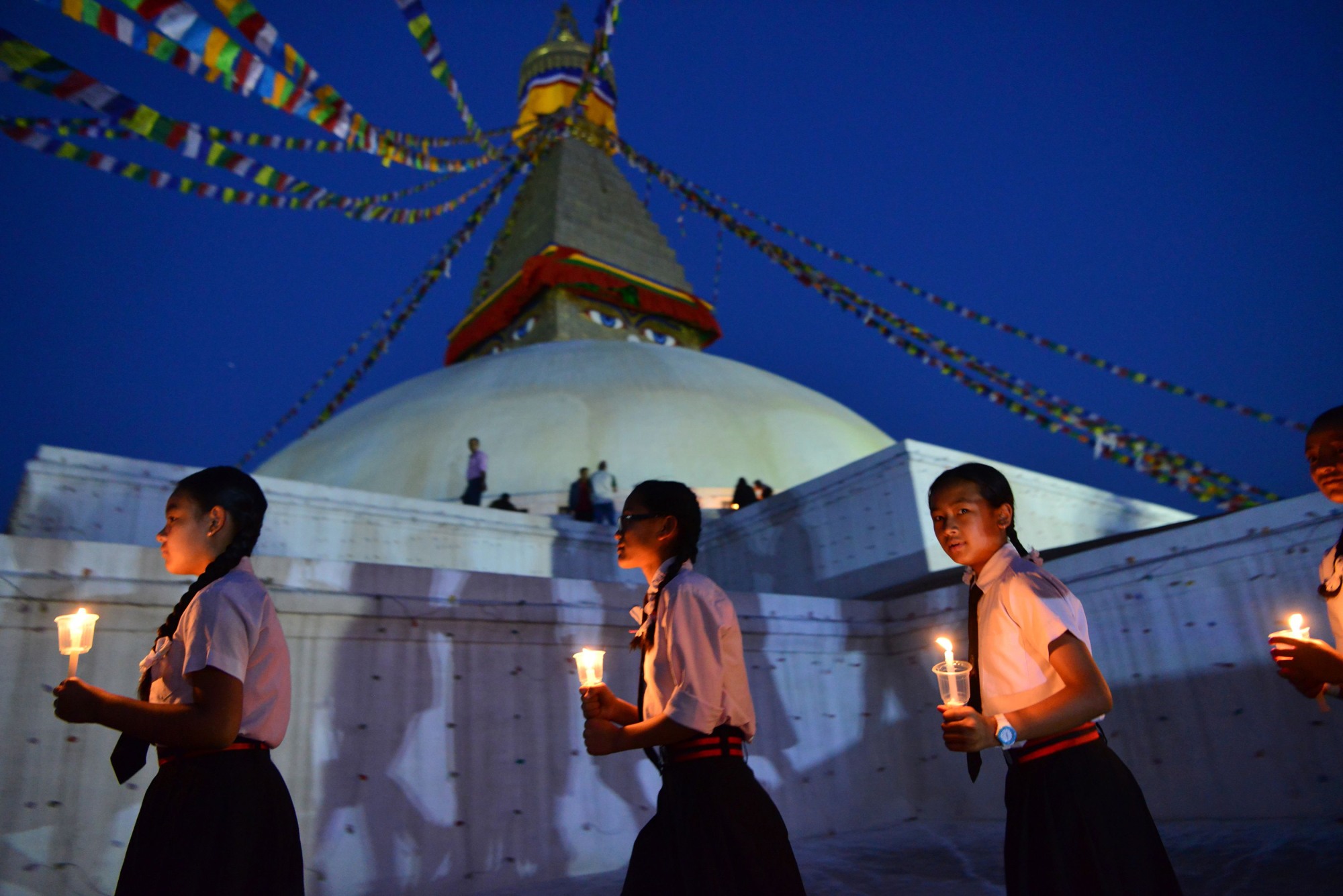 Nepalese schoolchildren take part in an April 25 ceremony in Kathmandu for the victims of the massive earthquake that struck the Himalayan nation on that day in 2015, claiming the lives of nearly 9,000 people. | AFP-JIJI