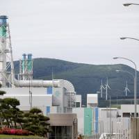 The Rokkasho nuclear fuel reprocessing plant under construction in Rokkasho, Aomori Prefecture. Japan currently possesses 48 tons of reactor-grade plutonium. | BLOOMBERG