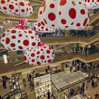 Bubbly: People shop at the newly opened Ginza Six mall in Tokyo. | AP