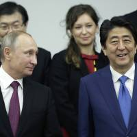 Prime Minister Shinzo Abe has pledge to resolve the Northern Territories dispute between Japan and Russia, but has made little progress on the issue despite holding two summits with Russian President Vladimir Putin in the past six months. | BLOOMBERG