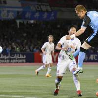 Kawasaki Frontale's Tatsuki Nara (right) scores on a second-half header against Hong Kong's Eastern SC on Tuesday in an Asian Champions League Group G match at Todoroki Stadium. Frontale won 4-0. | KYODO