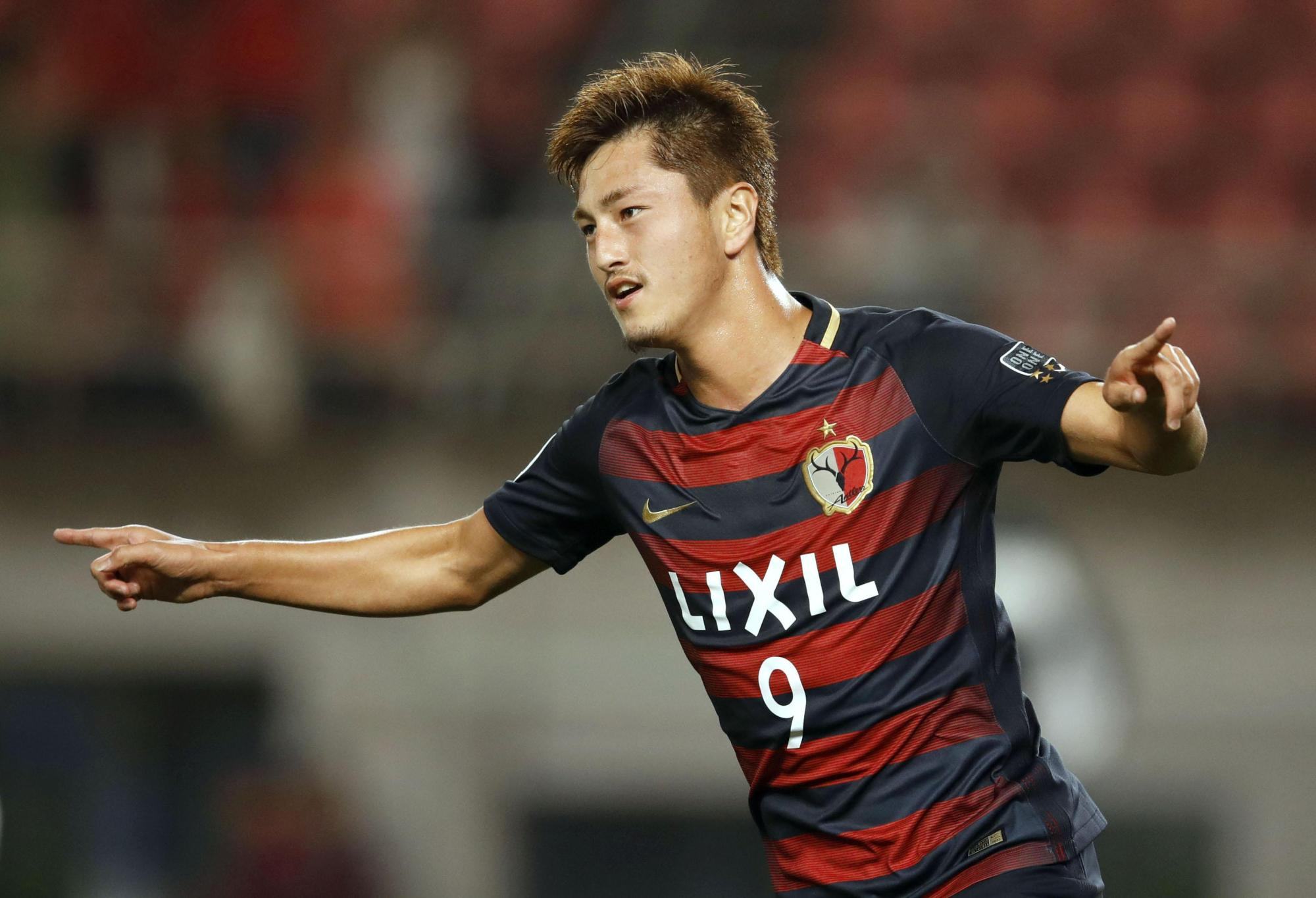 Kashima's Yuma Suzuki celebrates after scoring his second goal during Antlers' 2-1 win over Muangthong Unted in Asian Champions League action on Wednesday.   KYODO