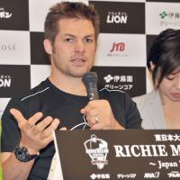 All Blacks legend Richie McCaw speaks at a news conference in Tokyo on Friday. | YOSHIAKI MIURA
