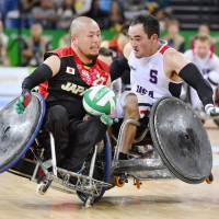 Seiya Norimatsu of Japan and Charles Aoki of the United States collide during their match at the Rio Paralympics in September 2016. | KYODO