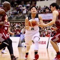 Alvark shooting guard Daiki Tanaka penetrates against the Brave Thunders during a game last December at Todoroki Arena. | KAZ NAGATSUKA