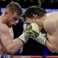 Alvarez dominates Chavez Jr., will face Golovkin next