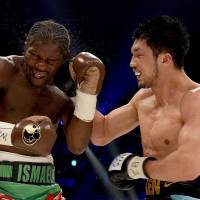 Ryota Murata (right) hits Hassan N'Dam during their middleweight title bout on Saturday. | AFP-JIJI