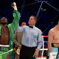 Ryota Murata (right) and Hassan N'Dam react after hearing the judges' scores after their title fight. | AFP-JIJI
